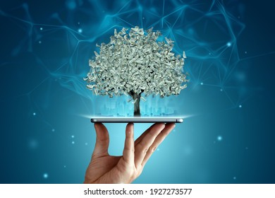 A money tree with dollars instead of leaves grows from a smartphone, work online. The concept of financial growth, passive income, dividends