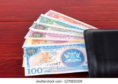 Money from Trinidad and Tobago in the black wallet