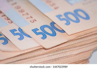 Money Ukrainian hryvnia big bundle of bills, close-up copy space