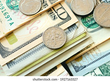 Money, US Dollar ( USD ). Coins and several money banknotes on a wooden table. Finance, savings and economy concept.