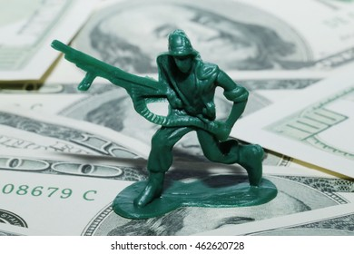 Money and War - American Soldiers and Profiteering - Toy commando on cash