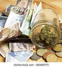 Money and Weed, American and Foreign Currency and Legal Marijuana and Cannabis