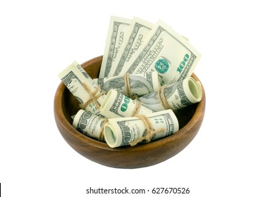 Money in a wooden bowl hundred dollar bills on white background