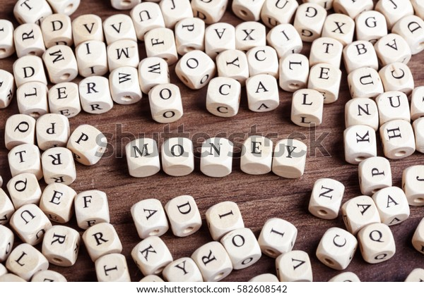 Money, word in letters on cube dices on table.