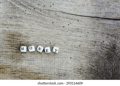 money-signs-on-wooden-texture