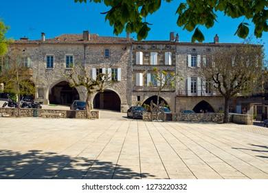 Monflanquin, France - April 6th, 2017: Historic architecture of the 'Place des Arcades' central square in Monflanquin, Lot-et-Garonne, France.
