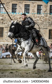 Monforte, Galicia/Spain - April 21 2019: Man disguised as a medieval knight riding a white horse with medieval trappings during the medieval fair of Monforte