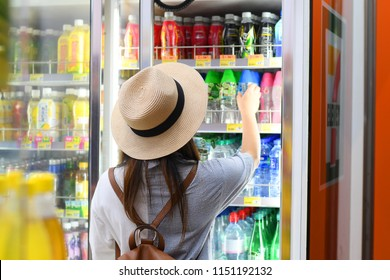 Mong Kok, Hong Kong: 03-Aug-2018 : Tourist is selecting softdrink in the convenience store in Hong Kong, China.