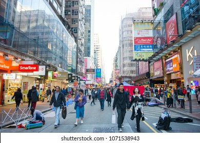 Mongkok ,Hong Kong - January 11, 2018 :Crowd people shopping and walking at Mong Kok shopping street, The Mongkok street is a very popular shopping place in Hong Kong