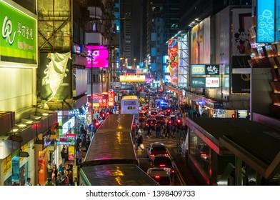 MONGKOK; HONGKONG MAR 2019 : Night life in Mong Kok hongkong Busy traffic and many tourists are walking shopping. In the street markets and lights from billboards