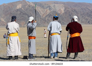 """MONGOLIA - 25 JULY: The  Mongolians archers in traditional clothing during the festival of name """"The Golden Eagle Festival"""" July 25, 2011, Mongolia - desert"""