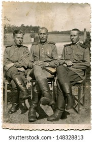 MONGOLIA - CIRCA 1939: Vintage photo shows Studio portrait of three Soviet soldiers - members fighting in the Halkin-Gol, 1939