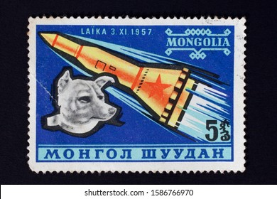 Mongolia - CIRCA 1957: Stamp printed in Mongolia shows Laika - first dog in space.