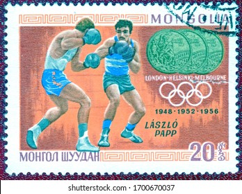 "MONGOLIA - CIRCA 1960: Postage stamp printed in Mongolia  with a picture Triple champion of Laszlo Papp (boxing), from the series ""Olympic champion""."