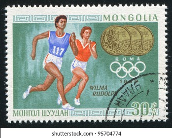 Wilma rudolph images stock photos vectors shutterstock mongolia circa 1968 a stamp printed by mongolia shows runner wilma rudolph voltagebd Choice Image