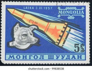 MONGOLIA - CIRCA 1976: A stamp printed in Mongolia shows Laika and rocket, circa 1976
