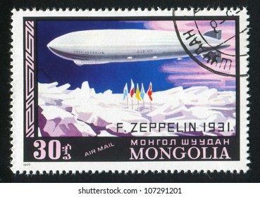 MONGOLIA - CIRCA 1977: A stamp printed by Mongolia, shows zeppelin over ice, circa 1977