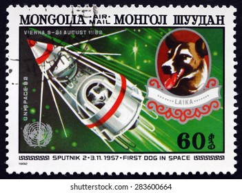 MONGOLIA - CIRCA 1982: a stamp printed in Mongolia shows Sputnik 2 and Laika, the First Dog in Space, circa 1982