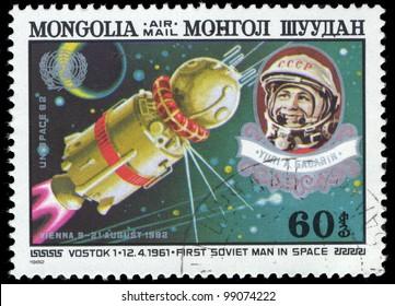 MONGOLIA - CIRCA 1982: A stamp printed in Mongolia shows Vostok 1 and Gagarin, circa 1982