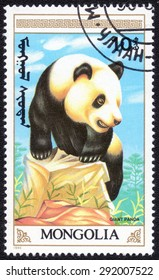 """MONGOLIA - CIRCA 1990 : A stamp printed by Mongolia shows a series of images """"Giant Panda"""", circa 1990"""