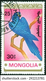 """MONGOLIA - CIRCA 1990: A stamp printed in Mongolia shows a series of images of """"Types of parrots"""", circa 1990"""