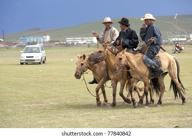 MONGOLIA - JULY 10: Traditional Annual Nadaam Festival, local nomads after the race on July 10, 2009 in Central Mongolia.