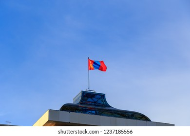 Mongolia, Ulaanbaatar - August 08, 2018: Flag of Mongolia set on The Government Palace is located on the north side of Genghis Square