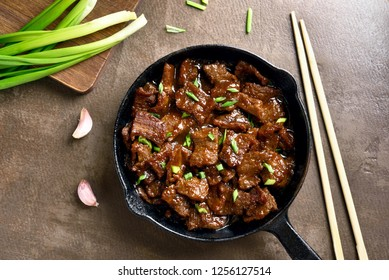 Mongolian beef. Pieces of beef stewed in soy sauce with spices in asian style. Top view,flat lay