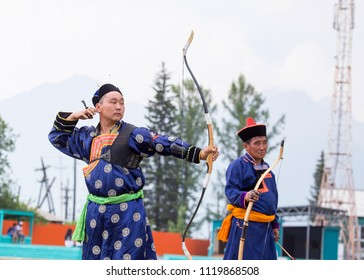 Mongolian competitions in archery in Siberia, where the athlete wears a traditional Buryat-Mongolian suit, shooting arrows during a national holiday.