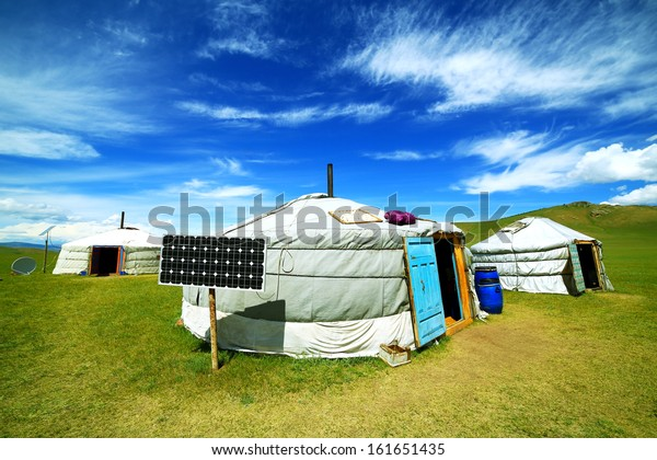 Mongolian ger camps with solar power, TV satellite and oxcart, Central Mongolia. Great contrast, modern and traditional lifestyle melting each other