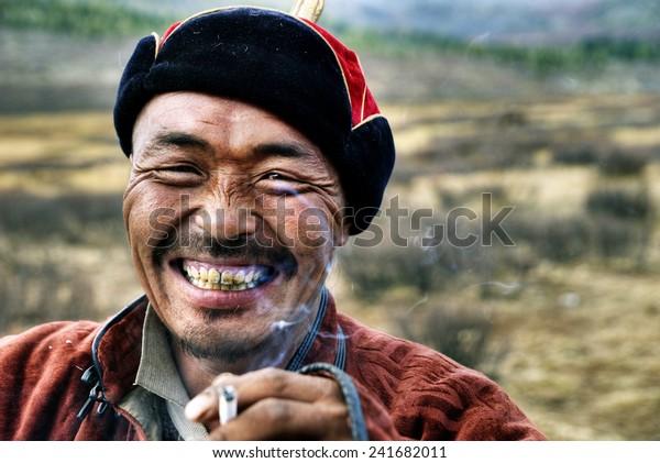 mongolian-man-smoking-600w-241682011.jpg