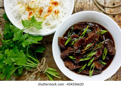 Mongolian meat - beef stewed in sauce with spices in asian style top view
