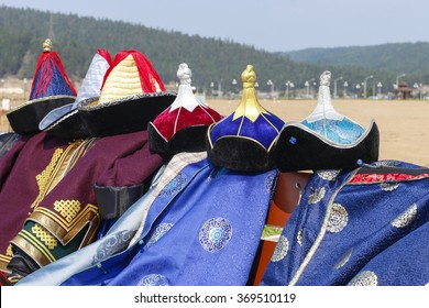 Mongolian national clothes with hats ying in a heap