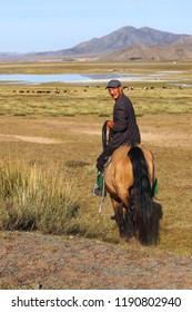 Mongolian shepherd on a horse. Nomad. Mongolia. September 2018