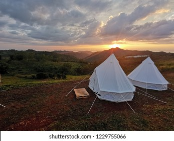 Mongolian tents in the middle of the field with a beautiful sky and cloud background.