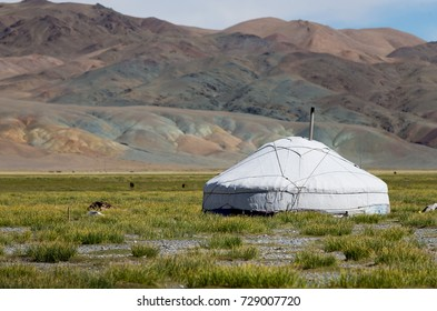 Mongolian yurt in steppe and mountains on the background. Bayan-Ölgii Province, Mongolia