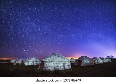 The Mongolian yurts and starry sky in night scenic.