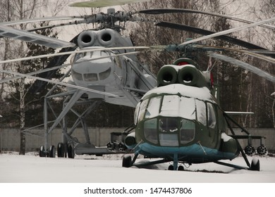 Monino, Moscow region, Russia. February 13, 2016. Military transport helicopter Mi-10 and Multipurpose helicopter Mi-8T in the open air at the air force Museum in Monino