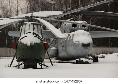 Monino, Moscow region, Russia. February 13, 2016. Multi-purpose mi-4A and Heavy military transport helicopter Mi-6 in the open air at the air force Museum in Monino