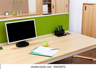 monitor on a desk in a modern office