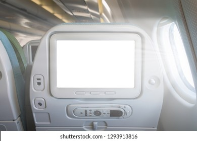 Monitor on the passenger seat in an airplane isoliroan on a white background.