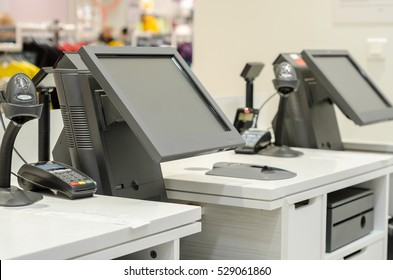 monitors the cash register in a shop selling
