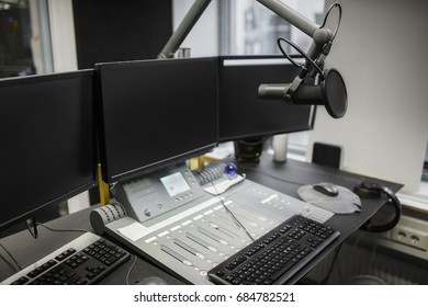 Monitors And Microphone Over Table In Radio Studio