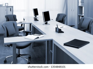 Monitors On The Desks In A Modern Office