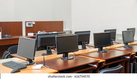 Monitors are on the tables in the computer classroom of the university