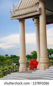 Monk and  beautiful of White Thai Temple  against blue sky at Sorapong's Temple in Nakhon Ratchasima Province, Thailand
