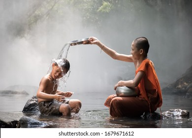 Monk and boy playing water