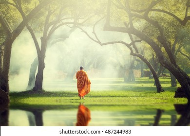 Monk collecting alms in morning