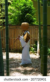 The Monk Covering His Face With A Bamboo Hat