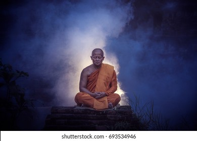 Monk doing meditation to follow The doctrine of the Buddha of Buddhism.